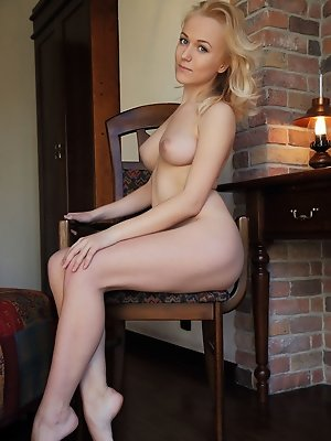 Aislin's soft feminine curves and nubile body contrasts nicely against the hard brick wall.
