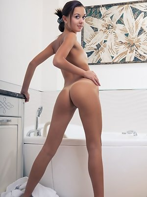 """Veselin treats us to a spectacular view of her perfectly tanned body with gorgeous caramel complexion. She takes off her bath robe and take a di"